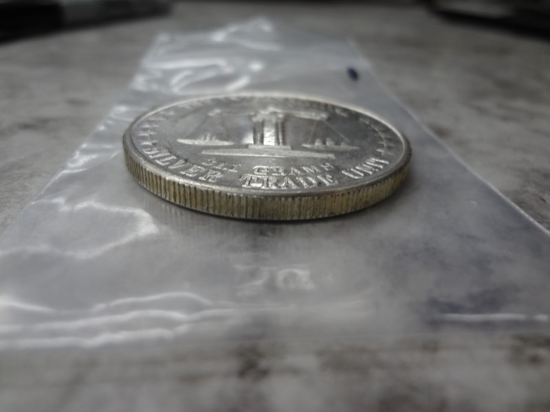 THE INTERNATIONAL SILVER TRADE UNIT AMERICA 1 TROY OUNCE COIN