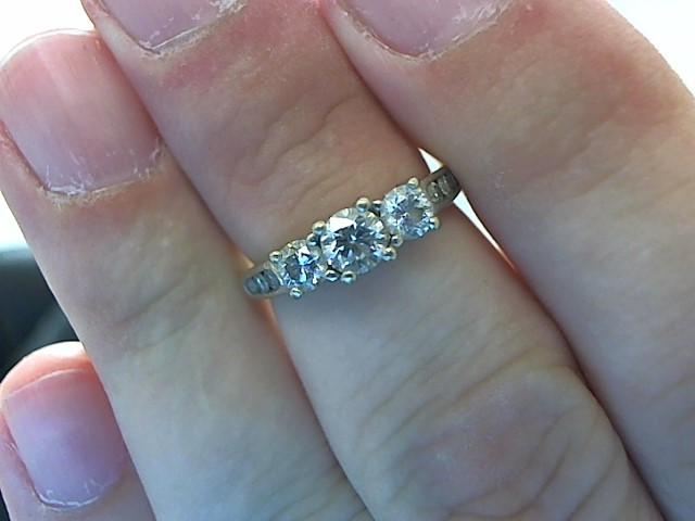 Lady's Diamond Fashion Ring 9 Diamonds .63 Carat T.W. 14K White Gold 3.3g