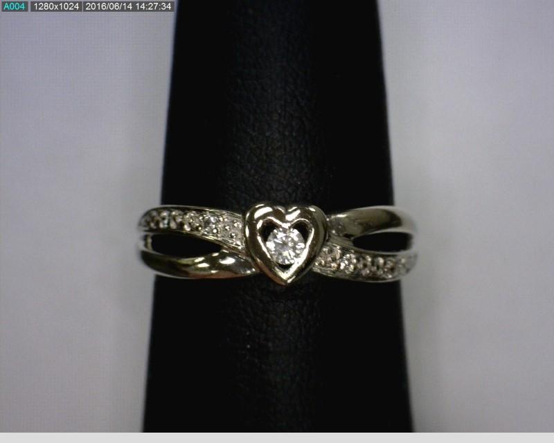 Lady's Diamond Fashion Ring 5 Diamonds .06 Carat T.W. 10K White Gold 1.64dwt