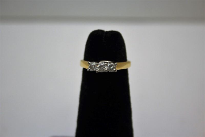 Lady's Diamond Fashion Ring 3 Diamonds .32 Carat T.W. 14K Yellow Gold 3.8g