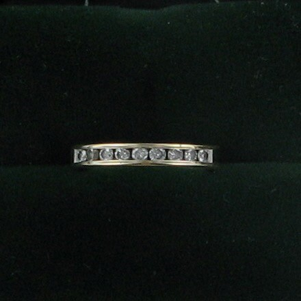 Lady's Diamond Wedding Band 9 Diamonds .27 Carat T.W. 14K Yellow Gold 1.7dwt