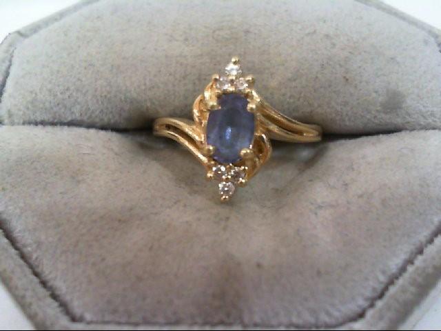 Tanzanite Lady's Stone & Diamond Ring 6 Diamonds .08 Carat T.W. 14K Yellow Gold