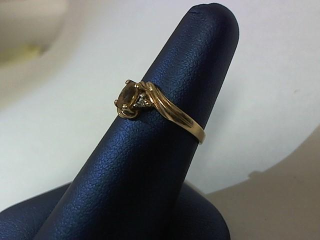 Yellow Stone Lady's Stone & Diamond Ring .001 CT. 10K Yellow Gold 2g Size:6.5