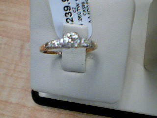 Lady's Diamond Solitaire Ring 3 Diamonds .26 Carat T.W. 14K Yellow Gold 1.5g