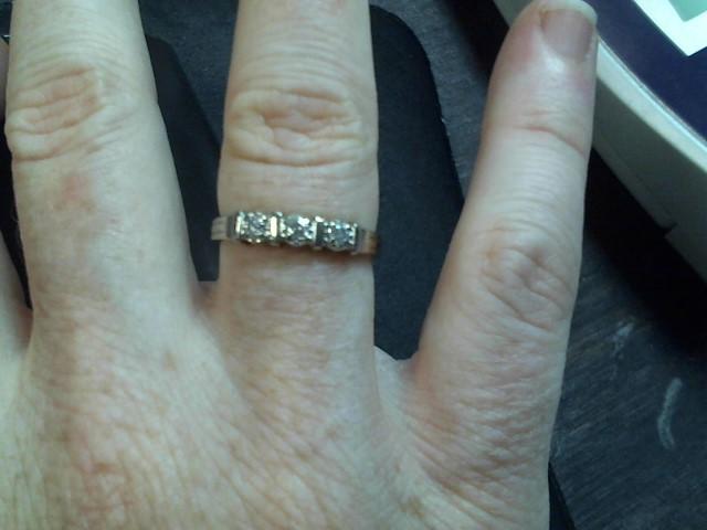Lady's Diamond Fashion Ring 3 Diamonds .06 Carat T.W. 10K White Gold 2.1g