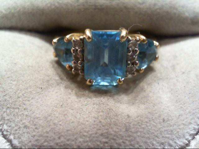 Lady's BLUE TOPAZ Ring 6 Diamonds .12 Carat T.W. 14K Yellow Gold 3.2g
