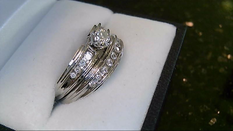 Lady's 14k white gold 1/5ct round diamond center with round diamonds in mounting