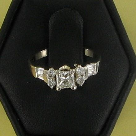 Lady's Diamond Solitaire Ring 9 Diamonds .72 Carat T.W. 14K White Gold 2.1dwt