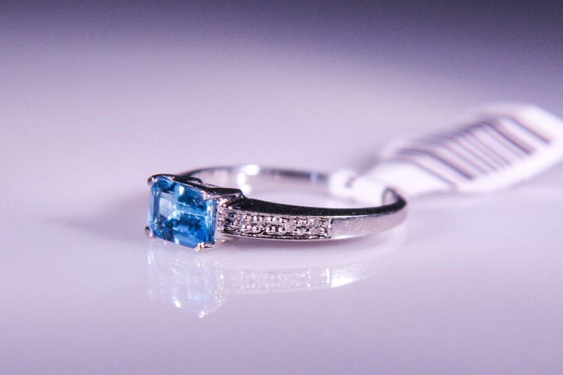 Synthetic Blue Topaz Lady's Stone & Diamond Ring 8 Diamonds .08 Carat T.W.