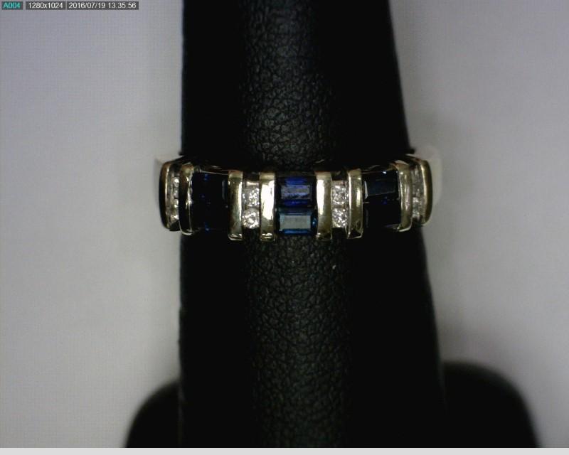 Sapphire Lady's Stone & Diamond Ring 8 Diamonds .16 Carat T.W. 14K White Gold