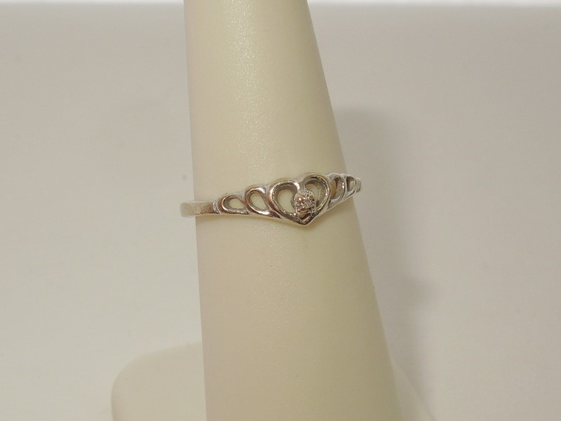 Lady's Diamond Solitaire Ring .002 CT. 10K White Gold 1.2g
