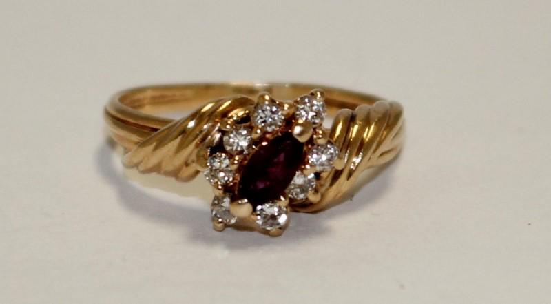 Red Stone Lady's Stone & Diamond Ring 8 Diamonds .24 Carat T.W. 14K Yellow Gold