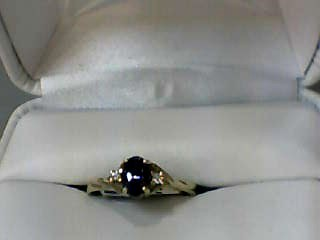 Synthetic Alexandrite Lady's Stone & Diamond Ring 2 Diamonds .06 Carat T.W.