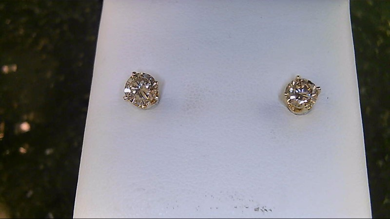 lady's 14k yellow gold diamond stud earrings