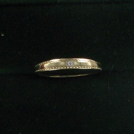 Lady's Diamond Wedding Band .02 CT. 18K Yellow Gold 1dwt