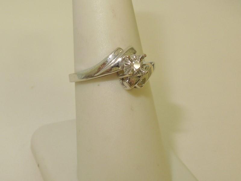 Lady's Diamond Fashion Ring .05 CT. 10K White Gold 2.3g