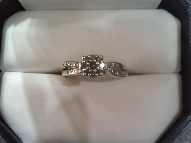 Lady's Silver-Diamond Ring 9 Diamonds .11 Carat T.W. 925 Silver 2.1g