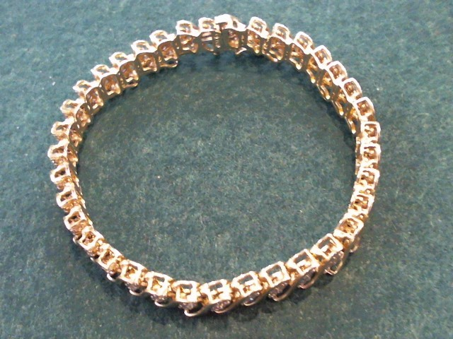 Gold-Diamond Bracelet 108 Diamonds 3.24 Carat T.W. 10K Yellow Gold 18g