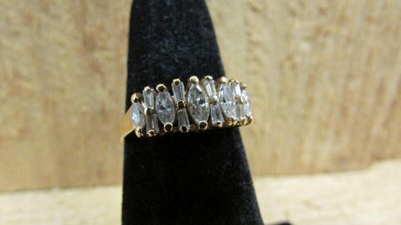 Lady's Diamond Fashion Ring 13 Diamonds .63 Carat T.W. 14K Yellow Gold 2.9g