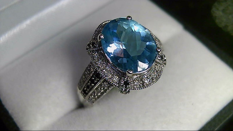 lady's 14k white gold blue topaz with white and black diamond ring