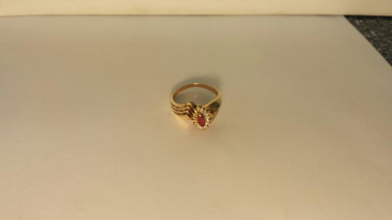 Red Stone Lady's Stone & Diamond Ring 8 Diamonds .08 Carat T.W. 10K Yellow Gold