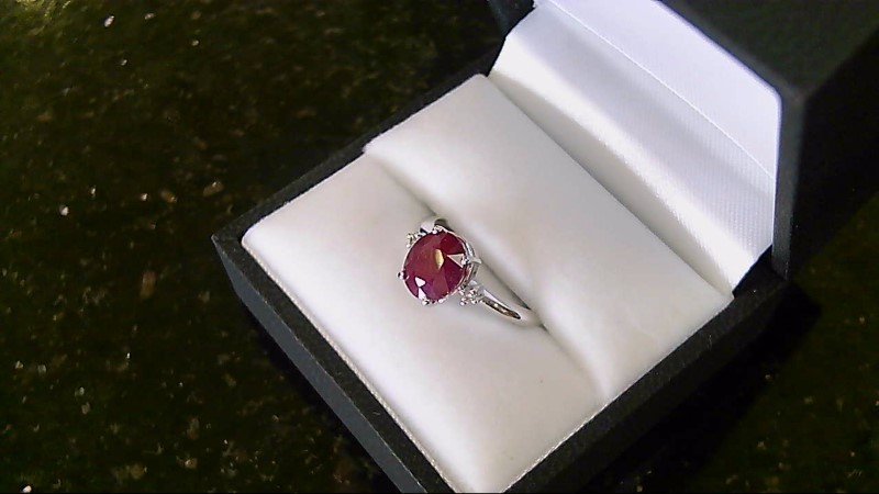 Lady's 14k white gold oval geniune ruby diamond ring