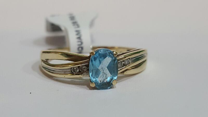 Aquamarine Lady's Stone & Diamond Ring 4 Diamonds .04 Carat T.W.