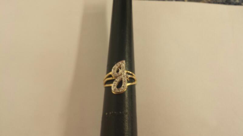 Lady's Diamond Cluster Ring 14 Diamonds .14 Carat T.W. 14K Yellow Gold 1.9dwt