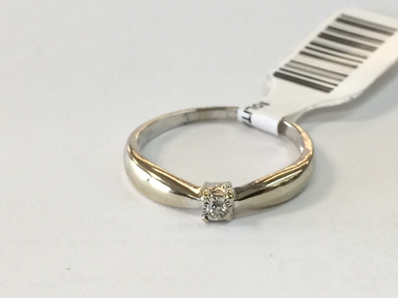 Lady's Diamond Solitaire Ring .01 CT. 10K White Gold 1.2dwt Size:7.5
