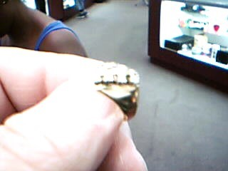 Lady's Diamond Fashion Ring 4 Diamonds .12 Carat T.W. 14K Yellow Gold 2.6g