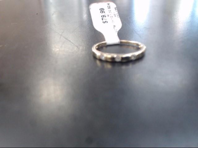 Lady's Gold-Diamond Ring Guard 3 Diamonds .12 Carat T.W. 10K Yellow Gold 1.3g