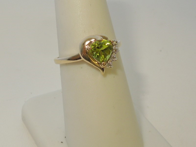 Synthetic Peridot Lady's Stone & Diamond Ring 4 Diamonds .020 Carat T.W.