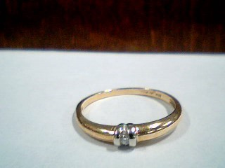 Lady's Diamond Solitaire Ring .04 CT. 10K 2 Tone Gold 1.5g Size:7.5