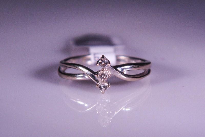 Lady's Diamond Fashion Ring 3 Diamonds .09 Carat T.W. 14K White Gold 2.3g