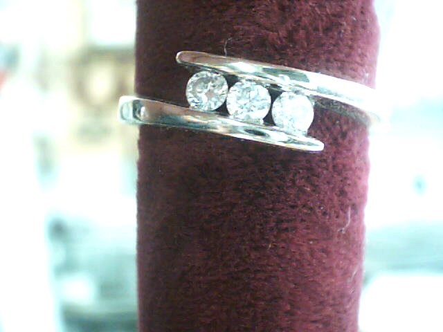 Lady's Diamond Fashion Ring 3 Diamonds .21 Carat T.W. 14K White Gold 2dwt