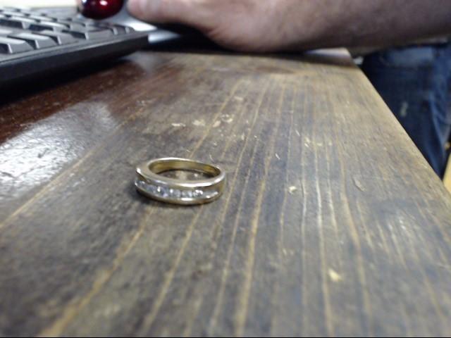Lady's Diamond Fashion Ring 7 Diamonds .07 Carat T.W. 10K Yellow Gold 6.8g