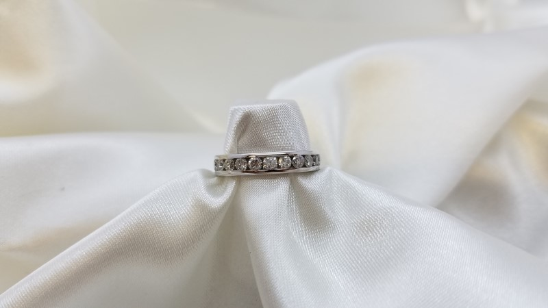 Lady's Diamond Channel Anniversary Ring 12 Diamonds .48 C.T.W. 14K White Gold