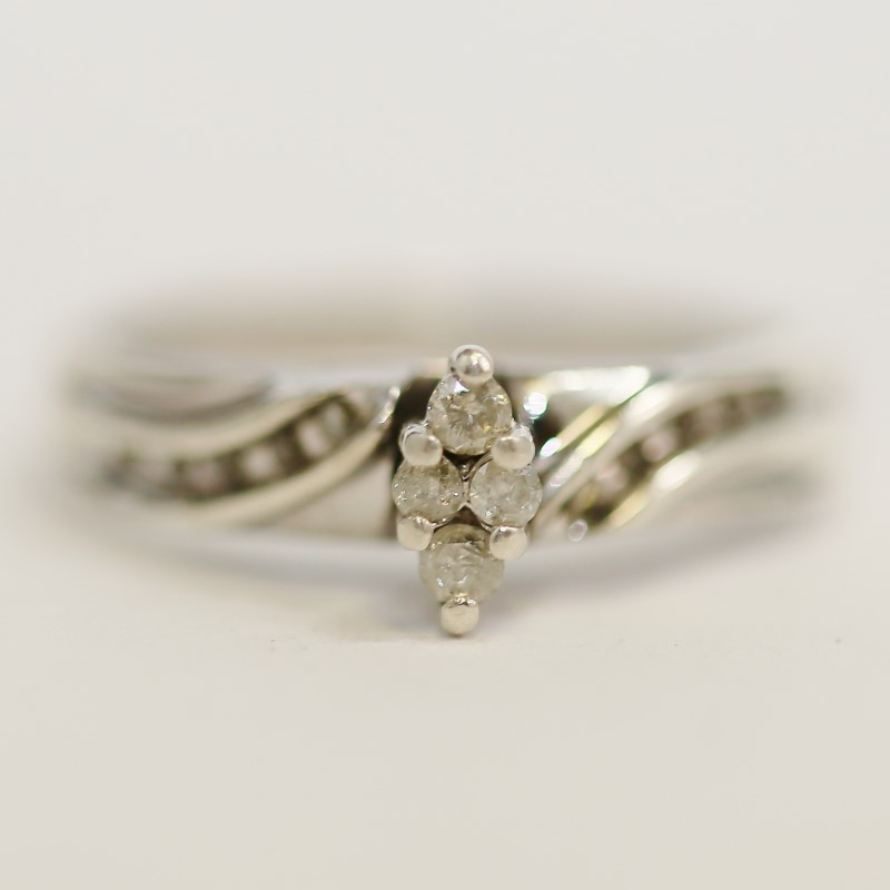 Lady's Silver-Diamond Ring 14 Diamonds .14 Carat T.W. 925 Silver 3.8g Size:6.8