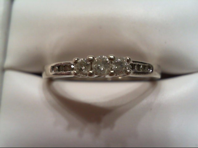 Lady's Silver-Diamond Ring 11 Diamonds .21 Carat T.W. 925 Silver 2.2g