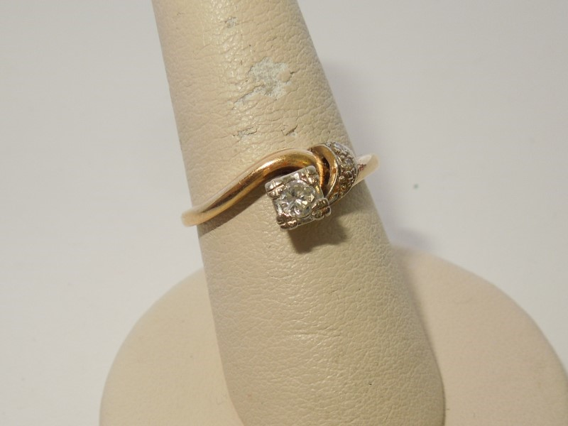 Lady's Diamond Fashion Ring 4 Diamonds .13 Carat T.W. 14K 2 Tone Gold 2.9g