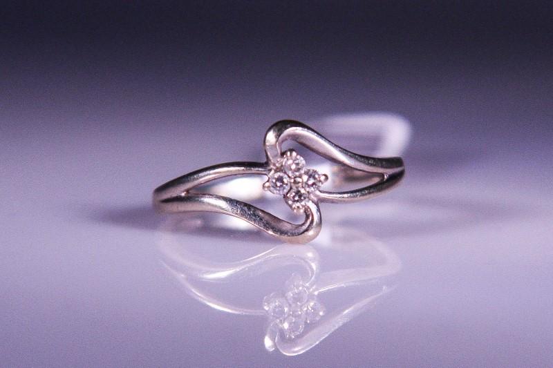 Lady's Diamond Fashion Ring 4 Diamonds .04 Carat T.W. 10K White Gold 1.9g