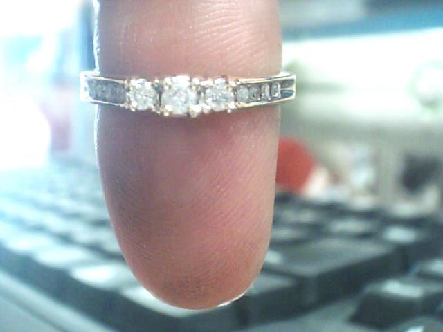 Lady's Diamond Fashion Ring 11 Diamonds .16 Carat T.W. 10K Yellow Gold 1.4dwt