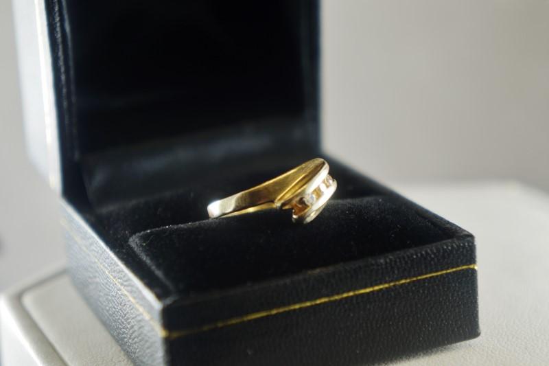 Lady's Diamond Fashion Ring 3 Diamonds .15 Carat T.W. 10K Yellow Gold 2.5g