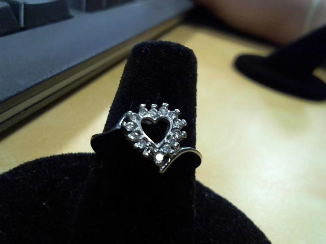Lady's Diamond Fashion Ring 13 Diamonds .13 Carat T.W. 14K White Gold 1.5g
