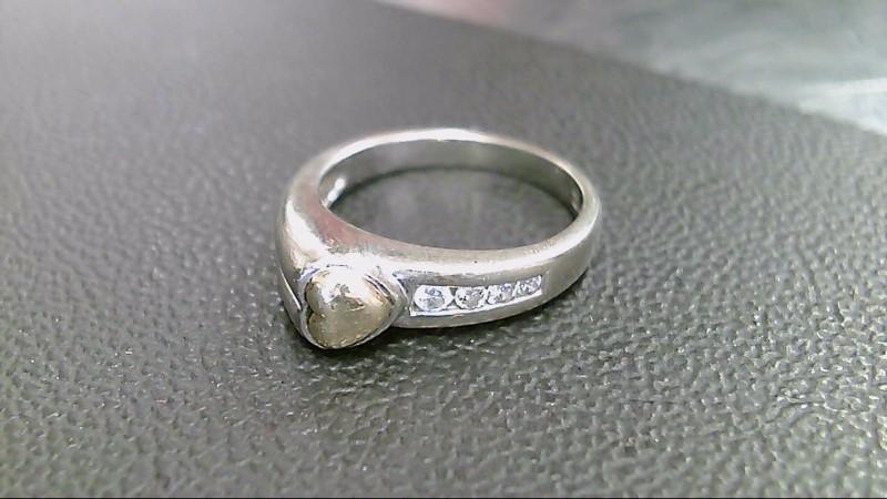 Lady's Diamond Fashion Ring 4 Diamonds .16 Carat T.W. 10K 2 Tone Gold 3.8g