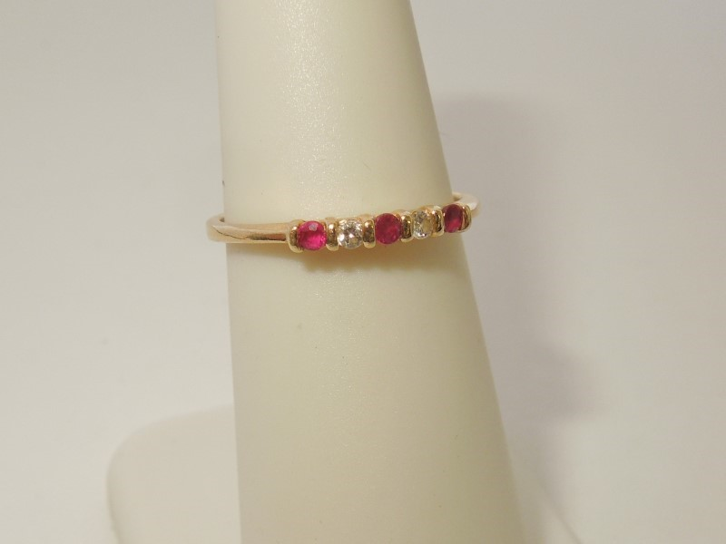 Synthetic Ruby Lady's Stone & Diamond Ring 2 Diamonds .06 Carat T.W.