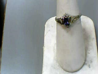 Tanzanite Lady's Stone & Diamond Ring 2 Diamonds .02 Carat T.W. 10K Yellow Gold
