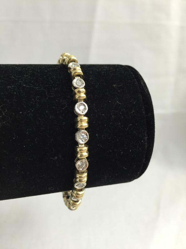 Gold-Diamond Bracelet 19 Diamonds .76 Carat T.W. 14K 2 Tone Gold 8.7dwt