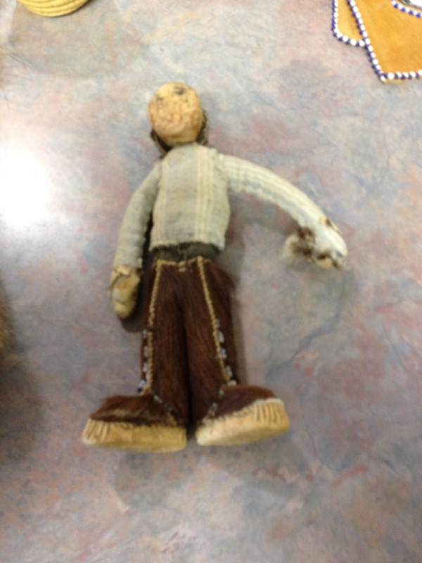 DOLL WITH WOODEN HEAD AND FUR PANTS