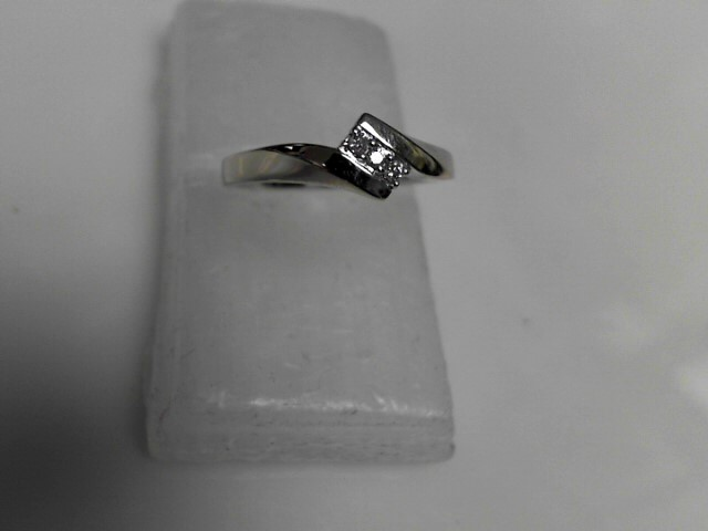 Diamond Ring 3 Diamonds .06 Carat T.W. 10K White Gold 1.81g